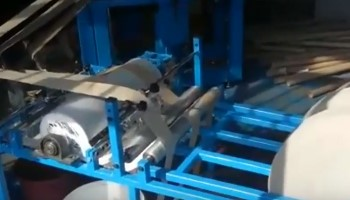 Cardboard tube manufacturing machine